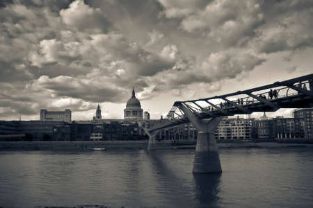 London photography containing Millennium Bridge, St. Paul's cathedral and other buildings with pronounced clouds