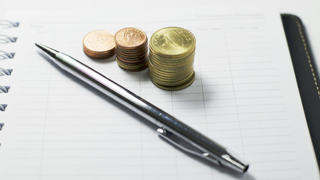 Currency coins and pens for Businees financial concept