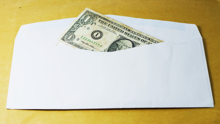 businees: white packet and dollar bank note Stock Photo