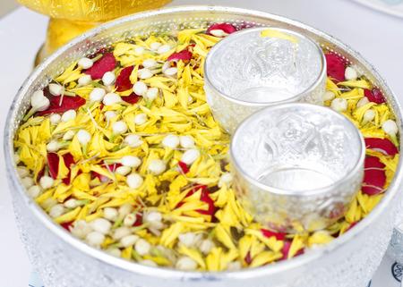 songkran: Songkran Water and flowers for songkran festival  Background