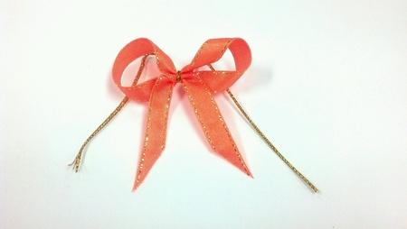 ribbon bow: Orange ribbon bow isolated on white background