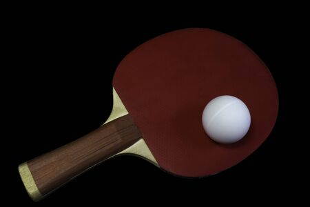 table tennis black racket and ball isolated on black background
