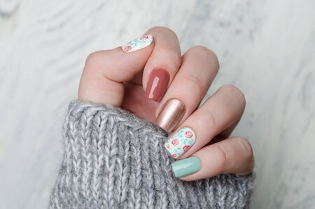 pink blue and gold manicure with floral print
