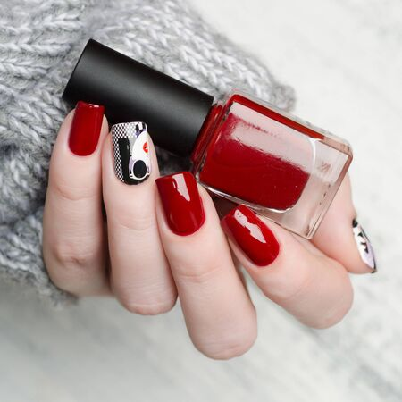 red manicure in the style of pop art pattern with a black white woman with red lips on checkered background
