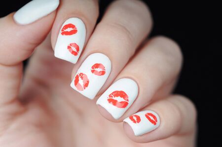 White manicure on st Valentine s Day with red lips pattern