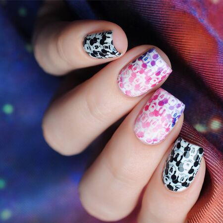 Manicure with a pattern Mickey Mouse black white on the background of space