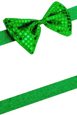 Background image with green bowtie and sparkly ribbon. Ribbon is cut and shaped from sparkly construction paper.
