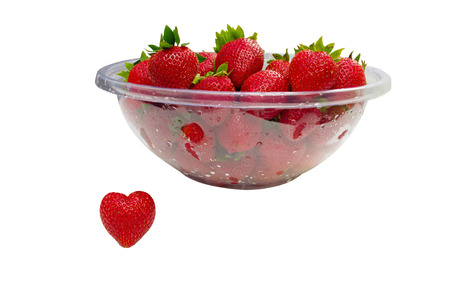 healthiness: Heart-shape strawberry represents loving strawberries as a favorite fruit or loving the healthiness of fresh strawberries.