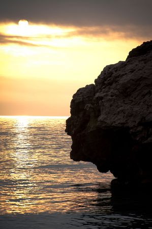 med: One of the rocks that reach out into the Med from Catalan Bay Gibraltar Stock Photo