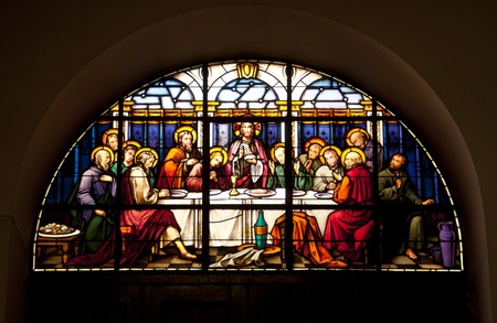 A stained glass window in Gibraltar showing the last supper. photo
