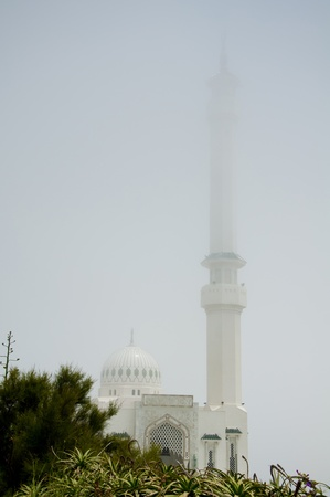 The mosque at Gibraltar sitting in the sea mist.