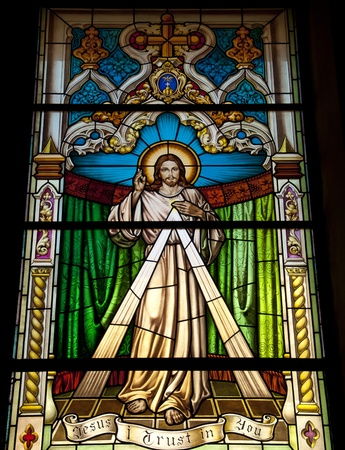 stained: A stained glass window in Gibraltar showing the Lord Jesus Christ Stock Photo