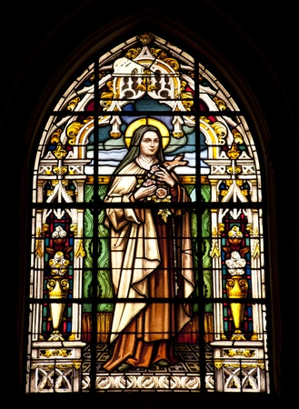 A stained glass window in Gibraltar showing the virgin mary Stock Photo