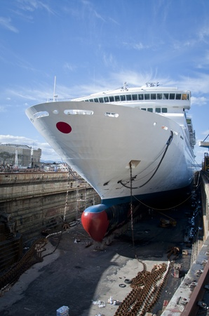 A Cruise Liner parked up in a drydock receiving maintenance work