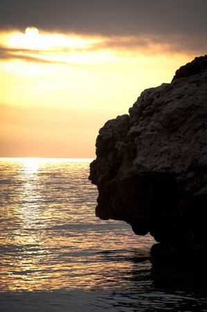 One of the rocks that reach out into the Med from Catalan Bay Gibraltar Stock Photo