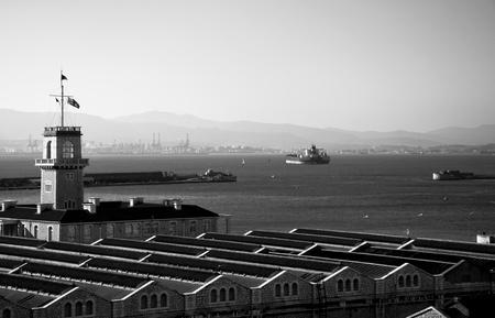 A black & white photo of the Gibraltar MOD Dockyard. Stock Photo