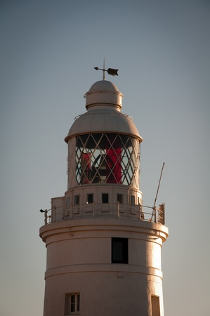 The Lighthouse at Europa Point Gibraltar, glowing in the morning sunshine Stock Photo - 13427761