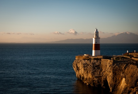 morocco: South facing view of the Lighthouse at Gibraltar with Morocco and Cueta in the distance.