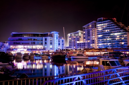 The famous marina in Gibraltar (Ocean Village) at night.