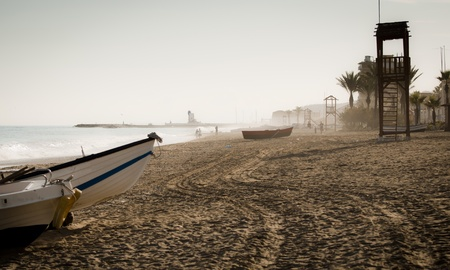 A view down the beach of Sabinillas looking towards the Puerto La Duquesa, Andalucia Spain. photo