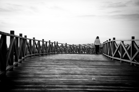 A morning walker keeping fit along the beachfront.