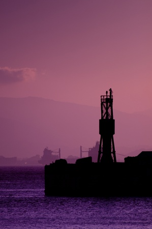 A silhouette of the Gibraltar Harbor taken at sunset. photo