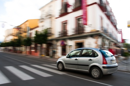 A motion shot showing a car driving through Ronda Spain.