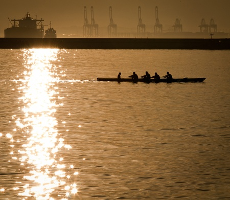 A team of rowers practicing throught the bay of Gibraltar