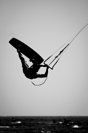 A Silhouette of a kite surfer in a Black   White finish  Stock Photo - 13485735