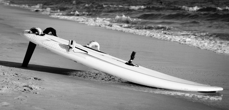A surfboard at the shoreline photographed in Black and White Stock Photo - 13485752