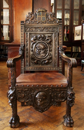 carpentery: This antique wooden chair sits in the grand Garrison Library in Gibraltar.