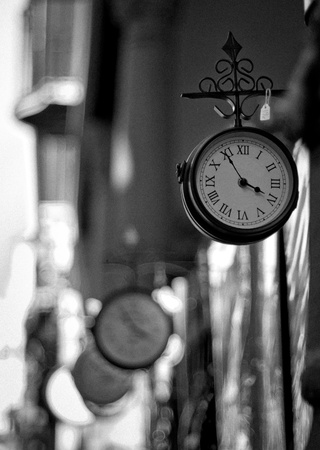 10 to 12 years: A selection of London Railway clocks for sale outside a shop in Southern Spain (with Grain effect)
