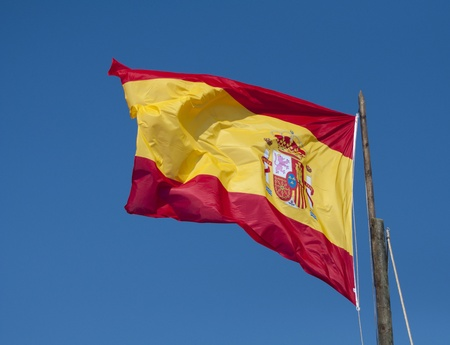 The Spanish National flag blowing in the wind. Stock Photo - 13529286