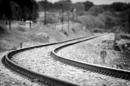 black train: A train track twisting and turning through the countryside in southern Spain Stock Photo
