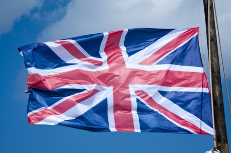 The Union Jack Flag blowing in the wind. Stock Photo - 13571675