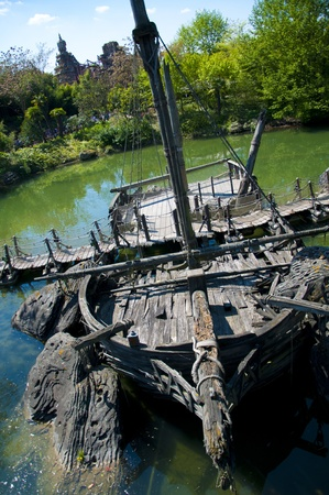 ship wreck: A shipwreck abandoned in a river, now being used to help support a walkbridge Stock Photo