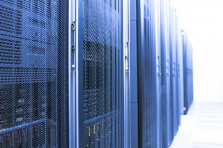 A server room with a blue filter fading into a white background