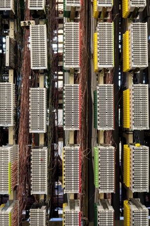 switchboard: A telephone network switchboard showing the various colours of cables  Stock Photo
