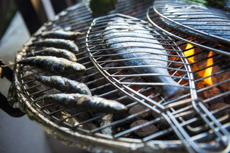 A healhty mediterranean BBQ consisting of fresh fish and vegetables