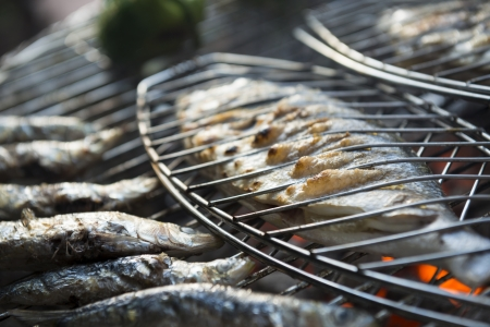 sardines: A healhty mediterranean BBQ consisting of fresh fish and vegetables