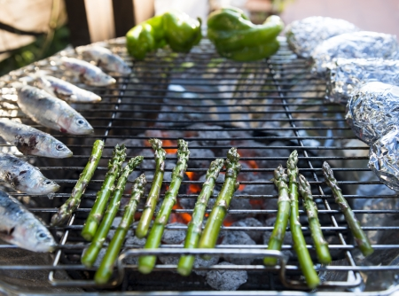 vegtables: A healhty mediterranean BBQ consisting of fresh fish and vegetables