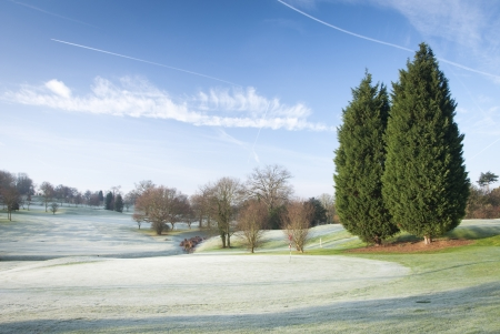 A golf course drapped in winter frost in the UK. Stock Photo