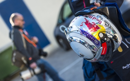 JEREZ (Spain) - FEBRUARY 11th: Sebastian Vettels helmet being carried by his mechanic leaving the garage on the first Test at the Jerez Circuit, Andalucia Spain 2013.