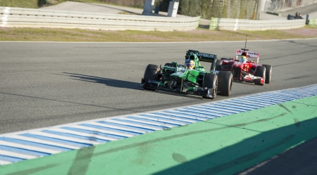 sterring: JEREZ (Spain) - FEBRUARY 10th: Charles Pic testing his new Caterham F1 car with Fellipe Massa driving his Ferrari in the distance on the first Test at the Jerez Circuit, Andalucia Spain 2013.