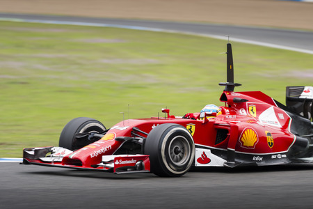 JEREZ, SPAIN - JANUARY 31: Fernando Alonso testing his new Ferrari F14 T F1 car on the first Test at the Jerez Circuit in Jerez, Andalucia, Spain on Jan. 31, 2014.