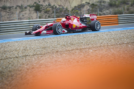 vettel: JEREZ, SPAIN - FEBRUARY 2ND: Sebastian Vettel testing his new Ferrari SF15-T F1 car on the first Test at the Jerez Circuit in Jerez, Andalucia, Spain on Feb. 2, 2015. Editorial
