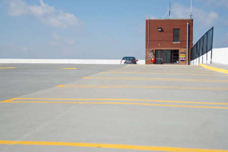 One car stands alone on an almost empty parking deck  photo