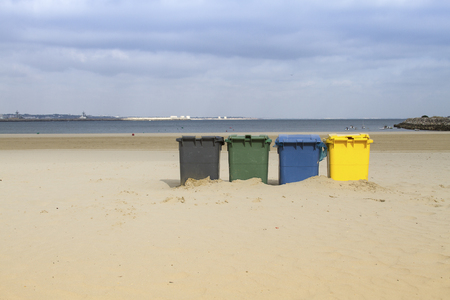 Trashcans on a beach