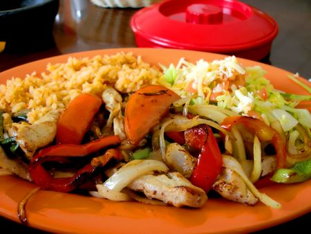 satisfying: Fajita Dinner on Orange Plate.