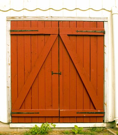 Close up of red barn doors